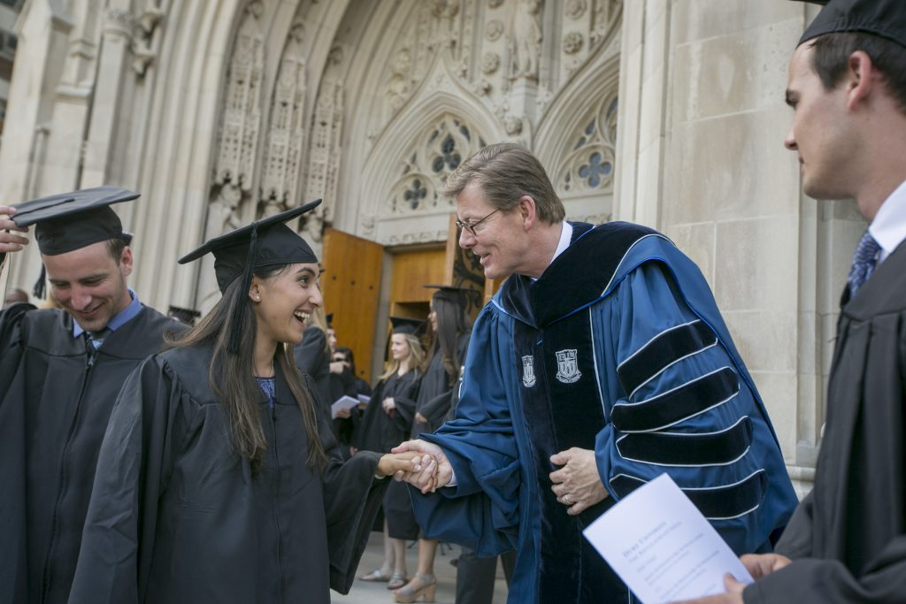 President Vincent Price greets prospective graduates during his first Baccalaureate Service at Duke Chapel.