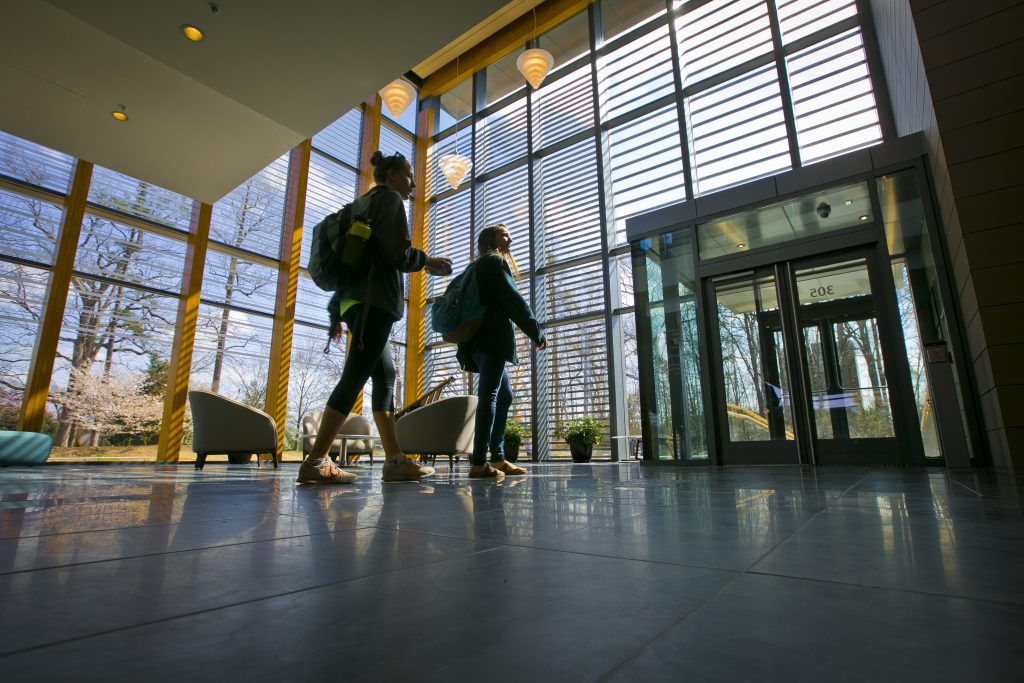 Two students walk through the Duke Student Wellness Center