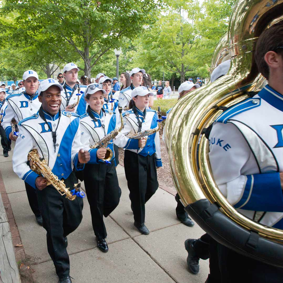 The Duke University Marching Band walks through campus in advance of a football game