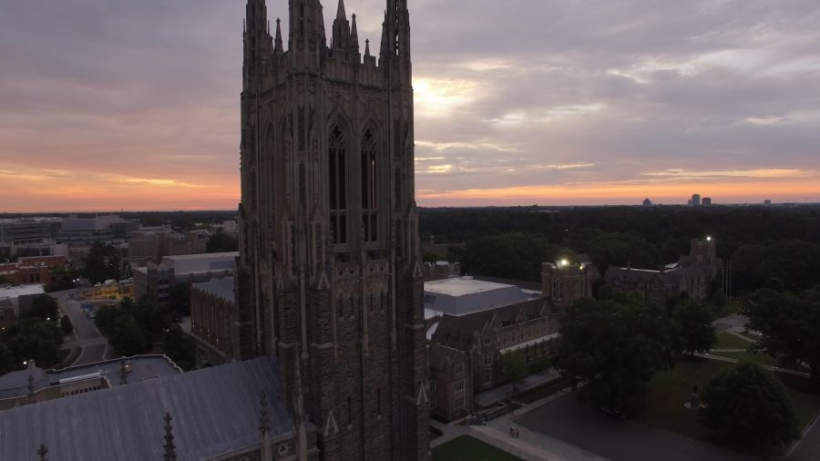 Aerial still of the sun rising over Duke Chapel